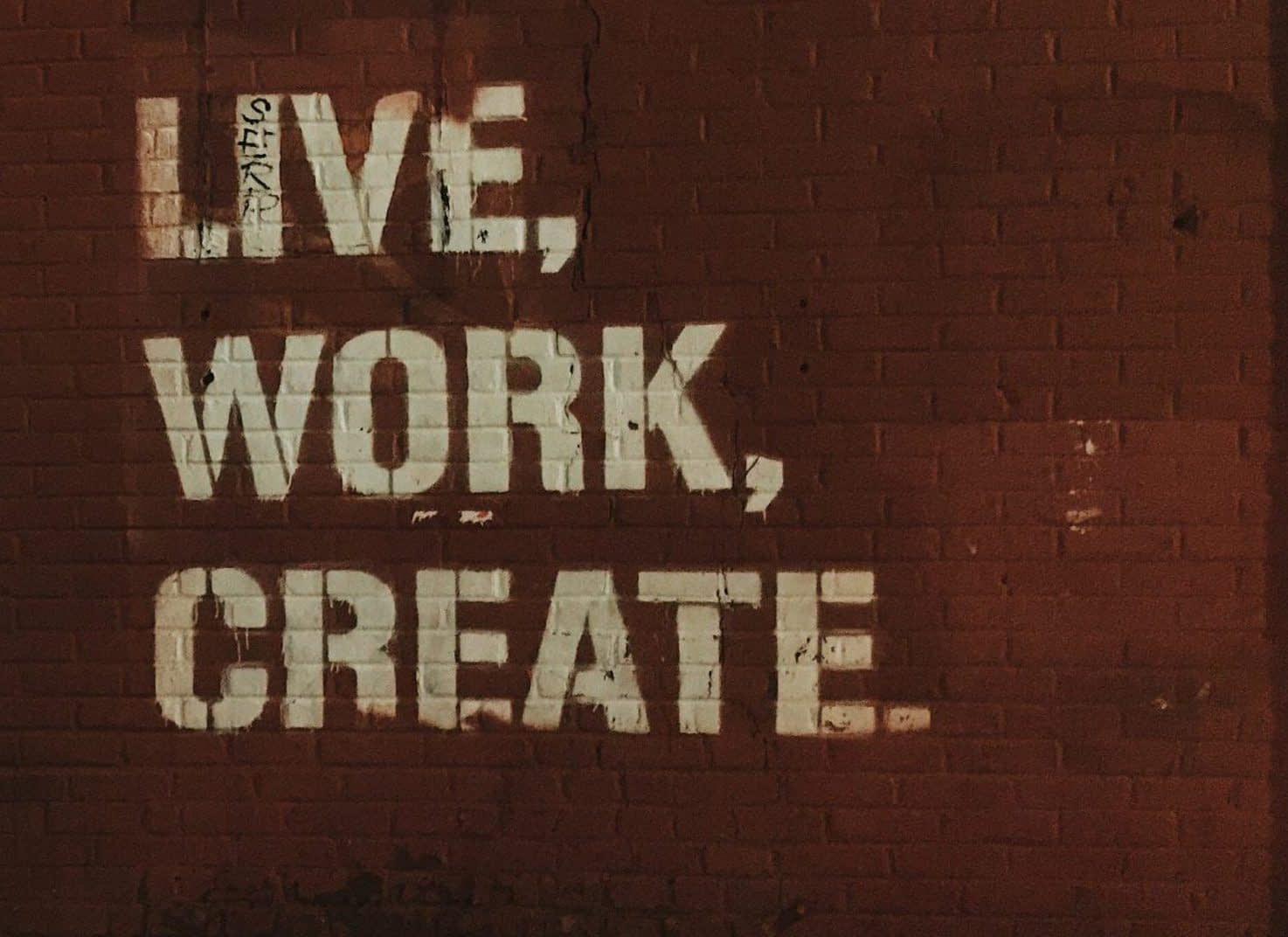 web design services red brick wall with live, work, create. quote