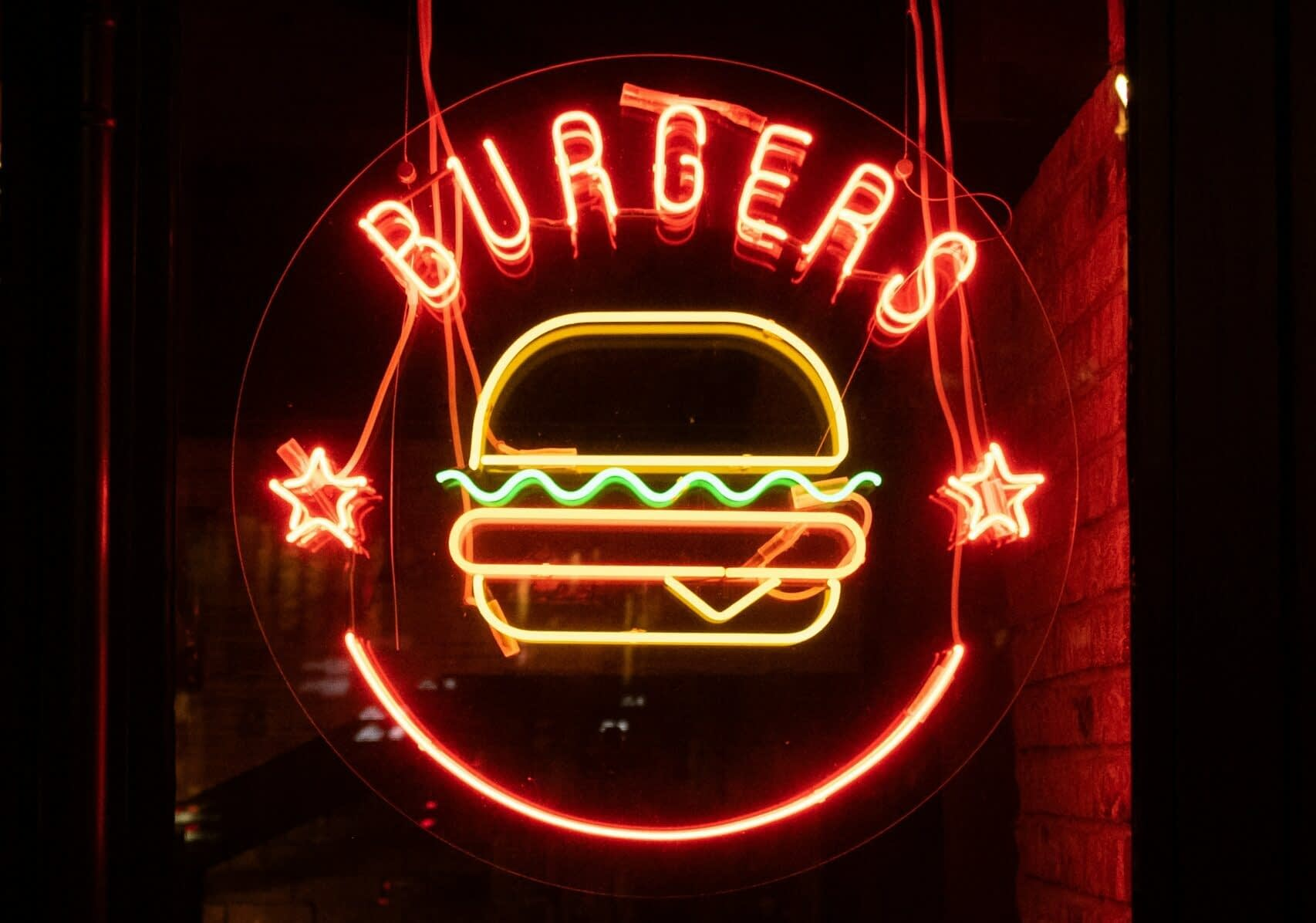 best burgers in helotes feature withred and yellow Burgers neon sign