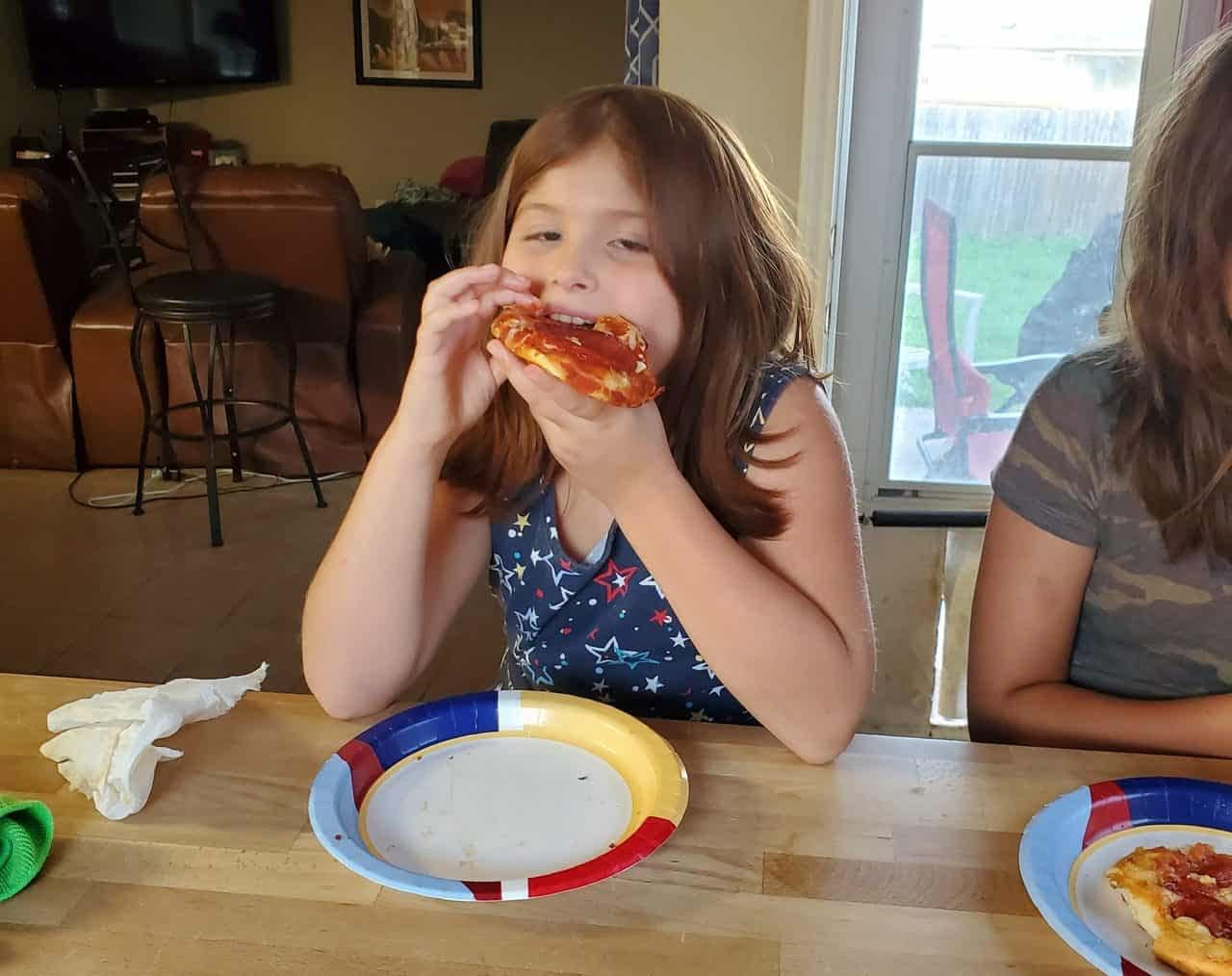 Maddie loving her personalized pizza