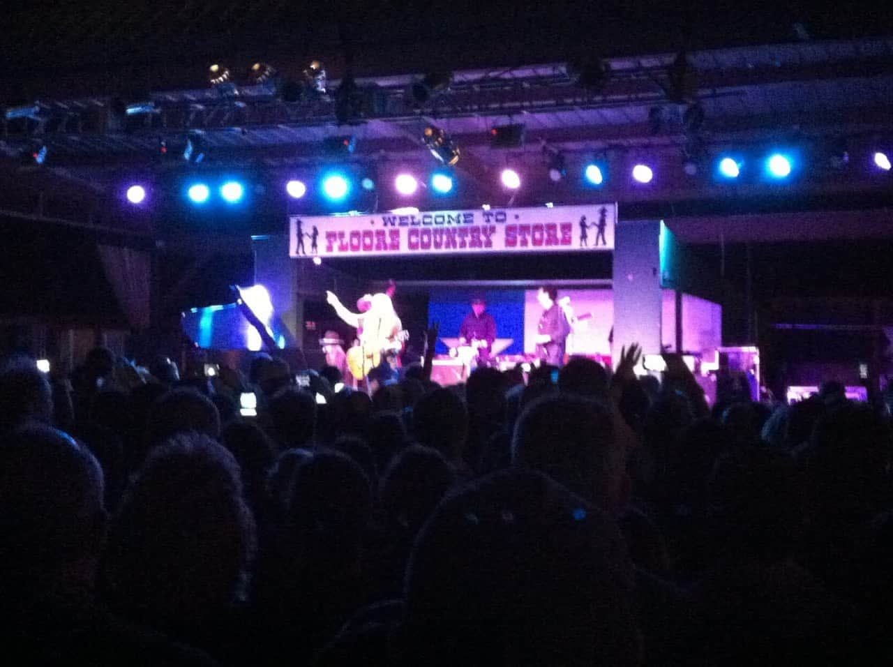 outdoor scene of floores country store during a night concert