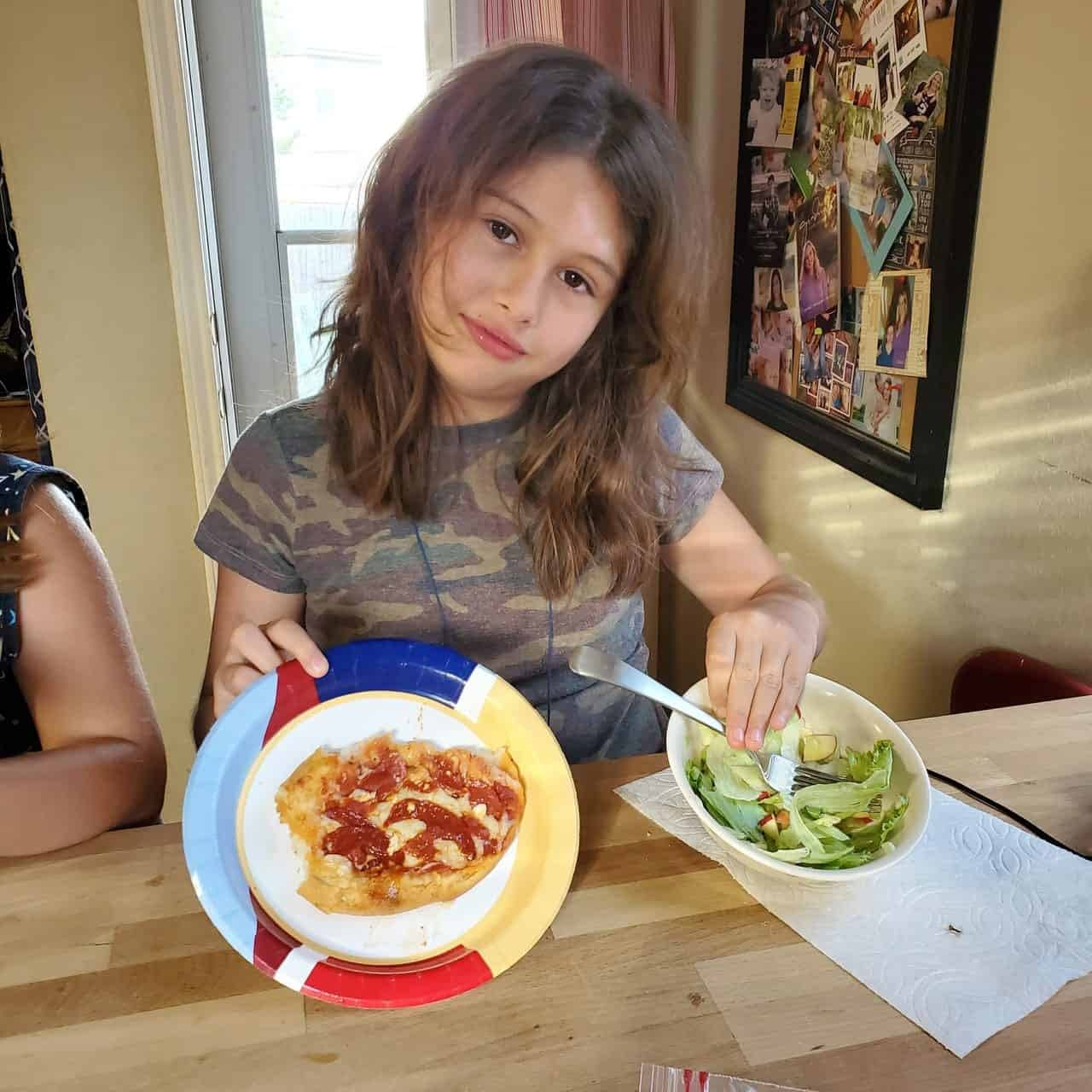 Mckayla showing her pizza creation scaled